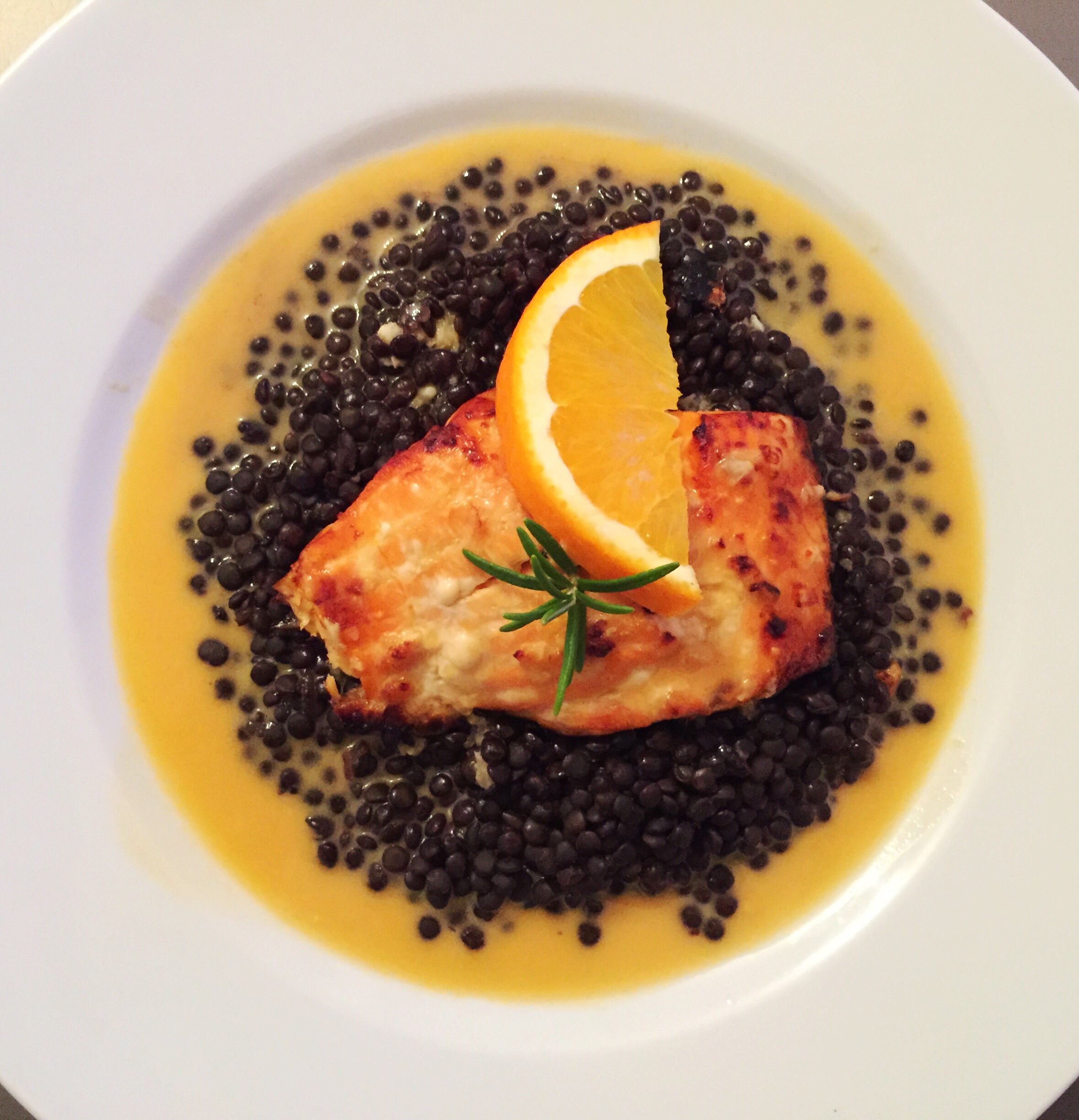 SALMON ON BELUGA LENTILS WITH ORANGE-COCONUT SAUCE
